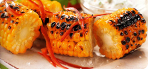 Char-grilled corn on the cob with herb dip