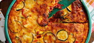 Crustless cheddar, onion and courgette quiche