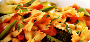 Farfalle with beans and green spring vegetables