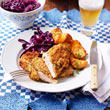 Pork schnitzel with sauerkraut and roasted new potatoes
