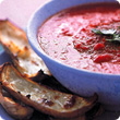 Red pepper soup with potato skins