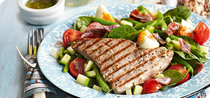 Tuna steaks on a Nicoise salad